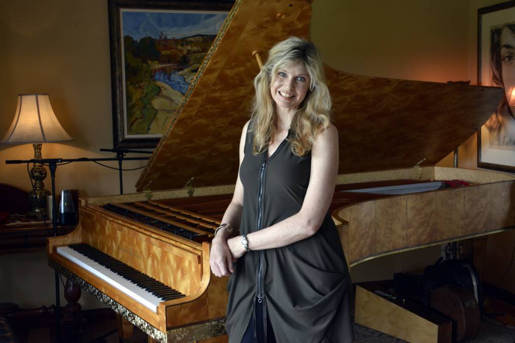 Busy calendar: Fiona Joy with her much-loved Stuart & Sons concert grand piano. Photo - PETER GLEESON